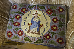 The embroidered cushion in the stall of Saint Mary Beodricsworth, Cathedral of Saint Edmundsbury.